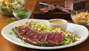 Sashimi-style Ahi Tuna seared rare and placed atop an Asian slaw. Served with a creamy ginger-soy sauce.